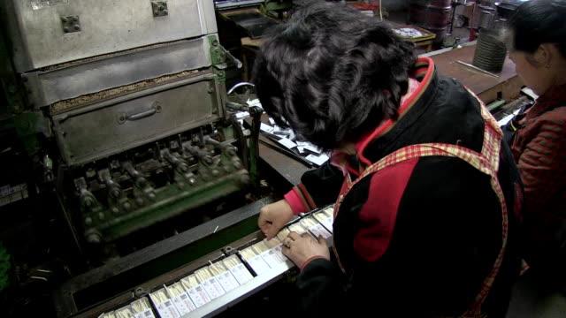 vídeos y material grabado en eventos de stock de ms shot of two korean women sort out defective products on production line inkorea match company factory / andong, gyeongsangbuk do, south korea  - fosforo