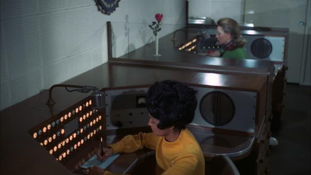 vídeos de stock, filmes e b-roll de ms shot of two ladies working at control room / new york, united states - secretária