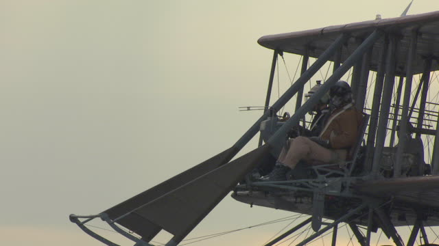 cu ts aerial shot of two men flying in wright b flyer airplane / dayton, ohio, united states - wright flyer stock-videos und b-roll-filmmaterial