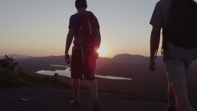 MS TU Shot of Two men hikiing and enjoying top of mountain peak in 100 Mile Wilderness of Northern / Maine, United States