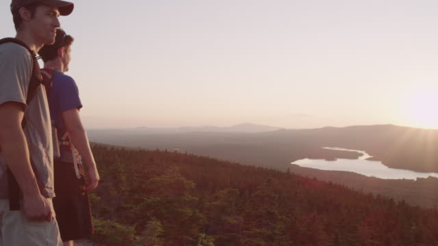 MS PAN Shot of Two men hikiing top of mountain peak in 100 Mile Wilderness of Northern / Maine, United States