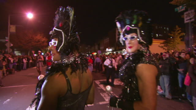 ms tu td shot of two men's in drag costumes pose during high heel race in dupont circle / washington, dist. of columbia, united states - drag queen stock videos and b-roll footage