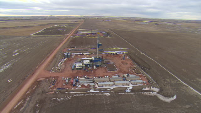 WS AERIAL DS Shot of two oil drilling rigs in Bakken oil field near Watford City / Watford City, North Dakota, United States