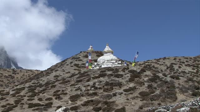 ms zi shot of two stupas (prayer stones) in village / dingboche, khumbu region, nepal - khumbu stock videos and b-roll footage