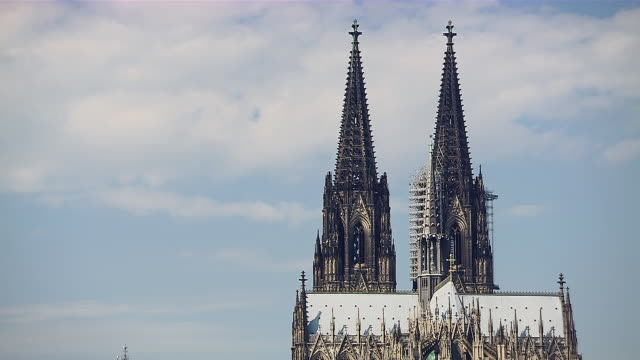 MS Shot of two towers top part of Cologne Cathedral peaks under blue sky / Cologne, North Rhine-Westphalia, Germany