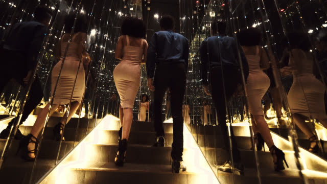 shot of two well dressed people walking upstairs - formal stock videos & royalty-free footage