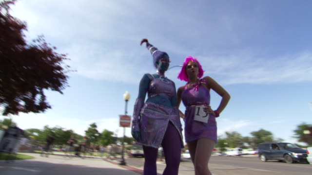 ms ds shot of two women dressed for roswell ufo festival costume contest / roswell, new mexico, united states - competition stock videos & royalty-free footage