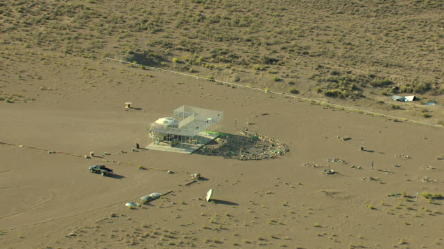 MS ZO AERIAL Shot of UFO watchtower and healing garden with crop circles with mountains / Hooper, Colorado, United States