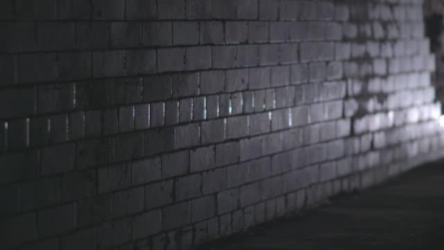 ms shot of underground subway wall  / cumberland railway station, nr. glasgow. scotland, united kingdom - セレクティブフォーカス点の映像素材/bロール