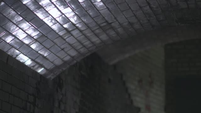 ms r/f shot of underground subway wall  / cumberland railway station, nr. glasgow. scotland, united kingdom - dissolvenza in chiusura video stock e b–roll