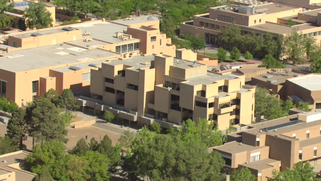 ms aerial shot of university of new mexico campus with pueblo style campus buildings / albuquerque, new mexico, united states - pueblo built structure stock videos & royalty-free footage