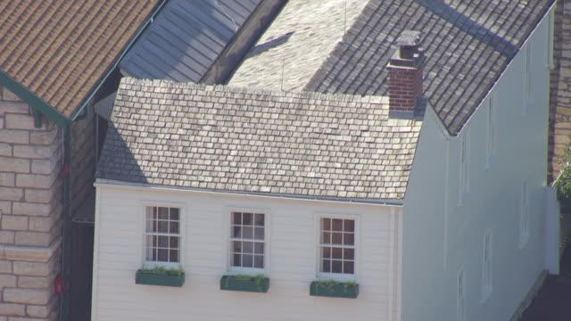 ms aerial shot of upper floor windows of mark twains boyhood home / hannibal, missouri, united states - mark twain stock videos & royalty-free footage