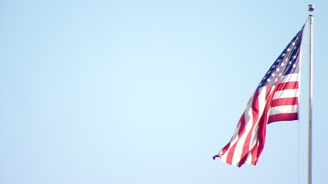 cu shot of us flag waving in wind / new york, united states - american flag stock videos and b-roll footage