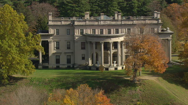 ms aerial tu zo shot of vanderbilt mansion with garden surrounded by trees at near river / new york, united states - mansion stock videos & royalty-free footage