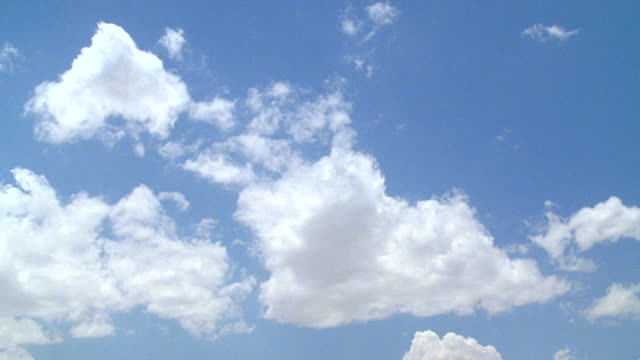 WS Shot of Various cloud formations against blue sky