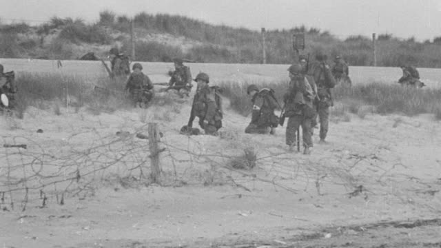 ws shot of various scenes of military news reel footage at war - coastal feature stock videos & royalty-free footage