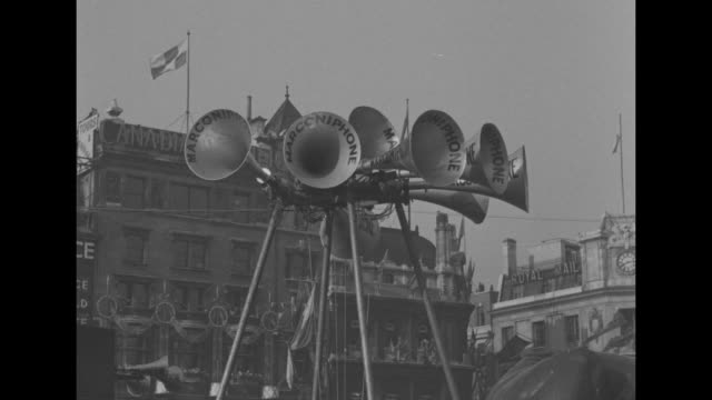 shot of victoria memorial in front of buckingham palace pan down to crowd around bottom of memorial / array of loudspeakers on poles clearly labeled... - 1935 stock videos & royalty-free footage