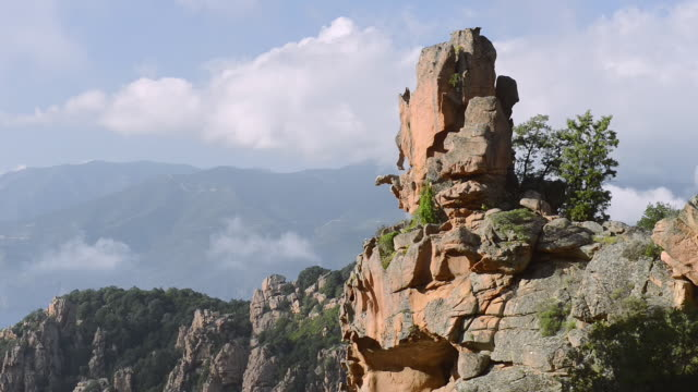ms shot of view over the fantastic rock landscape of the calanche of piana, unesco world heritage site / gulf of porto, corsica, france - igneous stock videos & royalty-free footage