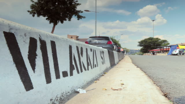 ms t/l la shot of vilakazi street in soweto / johannesburg, gauteng, south africa - soweto stock videos and b-roll footage