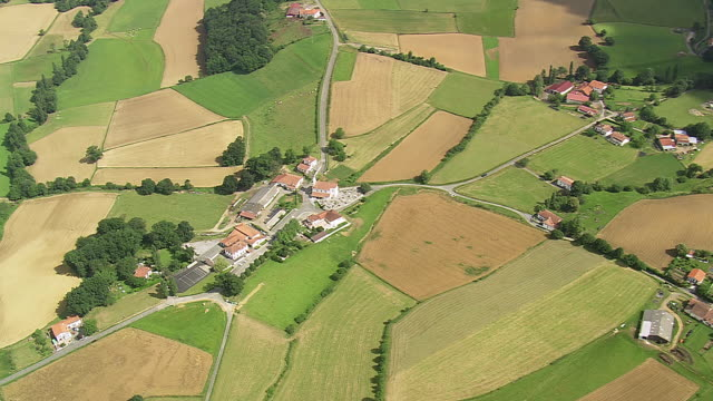 MS AERIAL Shot of village and farm fileds / Midi Pyrenees, France