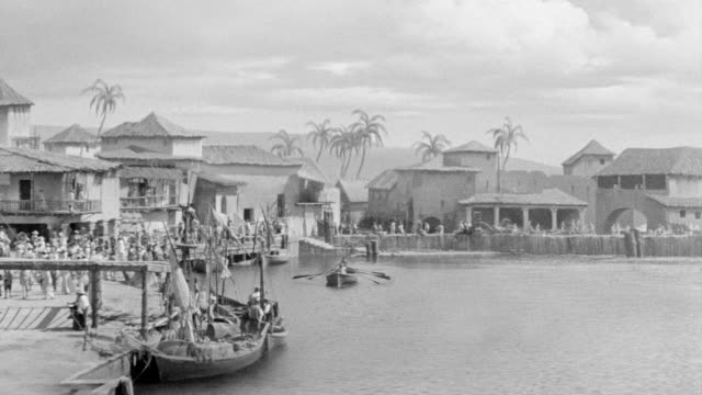 ms shot of village and harbor at port royal with people walking along marina - jamaica stock videos and b-roll footage