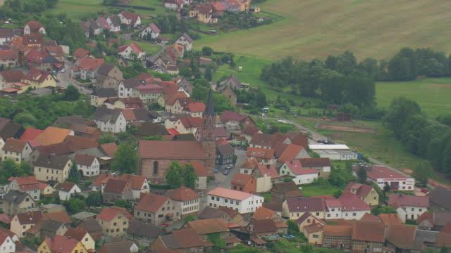 stockvideo's en b-roll-footage met ms aerial shot of village houses / germany - kerktoren