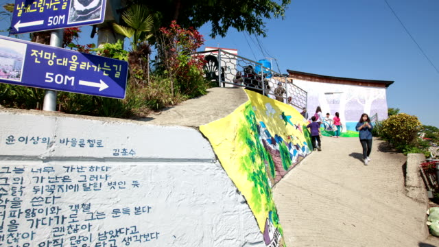 shot of visitors at dongpirang mural village - orthographic symbol stock videos and b-roll footage