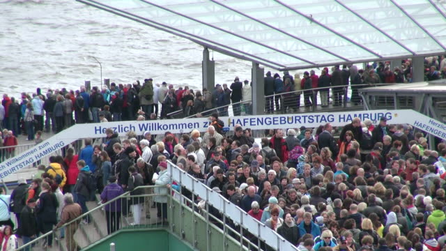 ms shot of visitors at landungsbrucken at harbour birthday / hamburg, germany - western script stock videos & royalty-free footage
