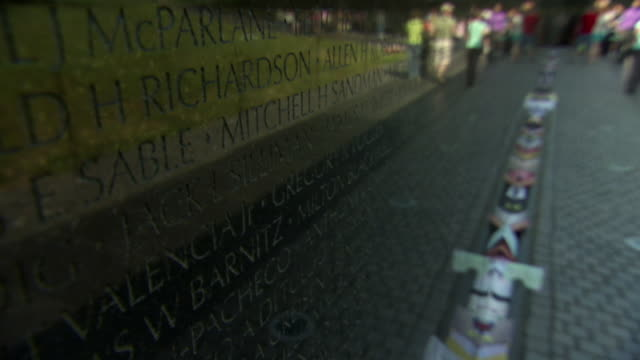 cu tu shot of visitors roaming at vietnam veterans memorial wall / washington, district of columbia, united states - vietnam veterans memorial video stock e b–roll