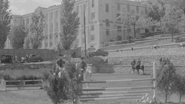 ms shot of v.m.i of cadets on horseback on course in front of official building - military school stock videos and b-roll footage