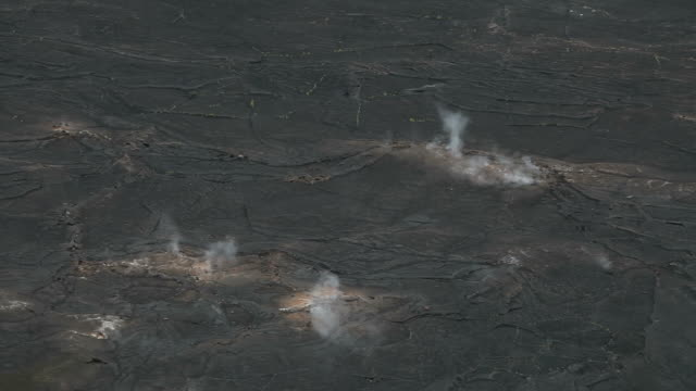 cu shot of volcanic steam rising from vent in black lava field on kilauea iki crater trail in volcanoes national park / volcano, hawall, big island, united states - kilauea stock videos & royalty-free footage