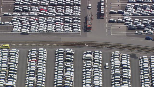 ms aerial shot of volkswagen factory car parking area / germany - volkswagen stock-videos und b-roll-filmmaterial