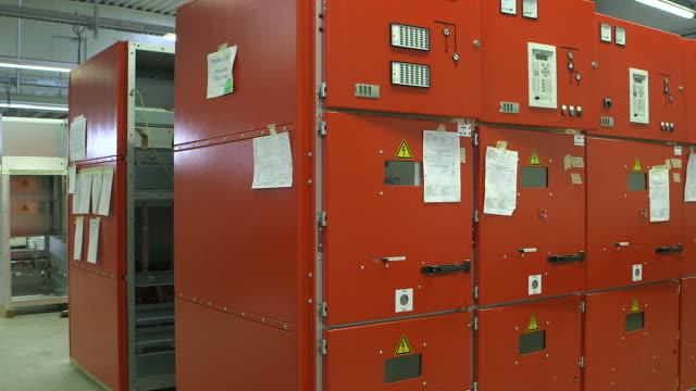 MS PAN Shot of voltage distribution switchgear assembly shop at switchgear plant / Konz, Rhineland Palatinate, Germany