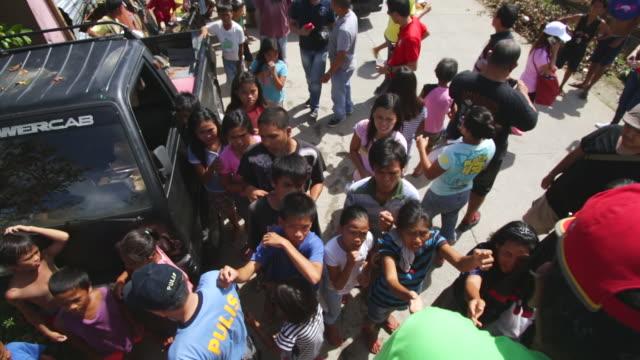 CU MS Shot of volunteers handing relief goods to help people in need / Leyte, Philippines