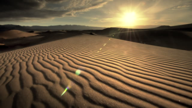 MS POV Shot of walking on sand dunes at sunset / Death Valley NP, California, United States