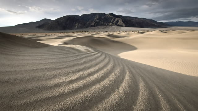 ms pov shot of walking on sand dunes / death valley np, california, united states - death valley national park stock videos & royalty-free footage
