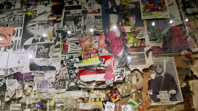 ms shot of wall covered with layers of posters announcing cbgb club performances at present day john varvatos store in the bowery neighborhood of manhattan / new york, united states  - music poster stock videos & royalty-free footage