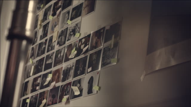 shot of wall covered with photo and adhesive note for storyline - photography stock-videos und b-roll-filmmaterial