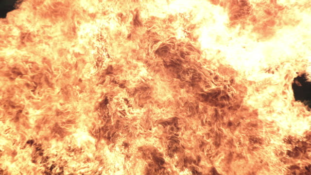 MS SLO MO Shot of wall of fire created by exploding petrol canister / United Kingdom