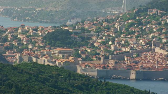 ms aerial pan shot of walled city on adriatic sea / dubrovnik, dubrovnik neretva county, croatia - adriatic sea stock videos & royalty-free footage