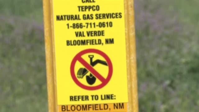 MS TU ZO Shot of warning sign of Gas Line / Durango, Colorado, United States
