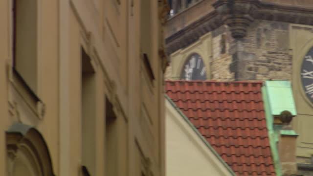 ms pan shot of watch on church building - römische zahl stock-videos und b-roll-filmmaterial