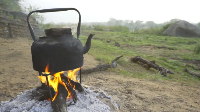 shot of water being boiled over fire - hluhluwe stock videos and b-roll footage