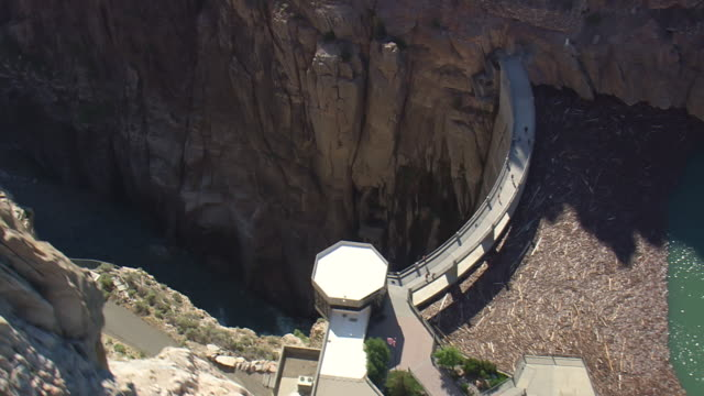 ms aerial shot of water coming out from buffalo bill dam / wyoming, united states - octagon stock videos & royalty-free footage