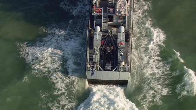 cu aerial zo shot of water splash to customs petrol craft / suffolk, france - police boat stock videos and b-roll footage