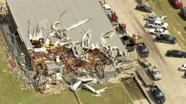 ws aerial td zi shot of water tower with people walking around looking at destroyed buildings and piggly wiggly with roof torn off / smithville, mississippi, united states - 2011 stock videos & royalty-free footage