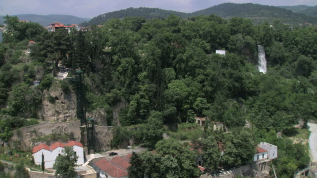 ms aerial ts shot of waterfall surrounded by trees / edessa, macedonia, greece  - macedonia country stock videos and b-roll footage