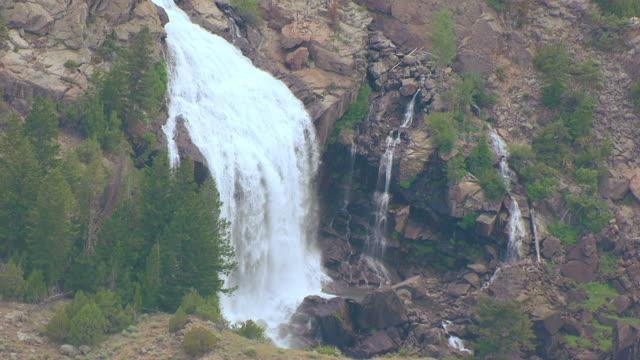 ms aerial zi shot of waterfall west of washakie reservoir / wyoming, united states - gravitationsfält bildbanksvideor och videomaterial från bakom kulisserna