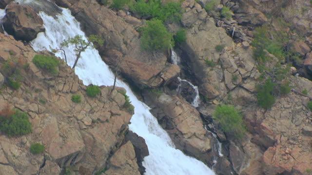 ms aerial ts tu shot of waterfall west of washakie reservoir / wyoming, united states - gravitationsfält bildbanksvideor och videomaterial från bakom kulisserna