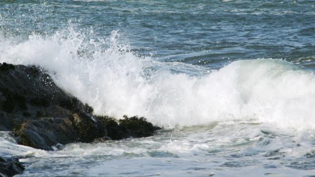 ms slo mo pan shot of waves breaking on shore rocks / harris island, scotland, united kingdom - 2k resolution stock videos and b-roll footage